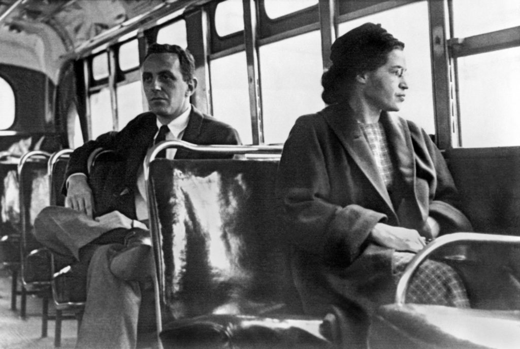 Rosa Parks riding a Montgomery bus immediately following the decision to desegregate buses.
