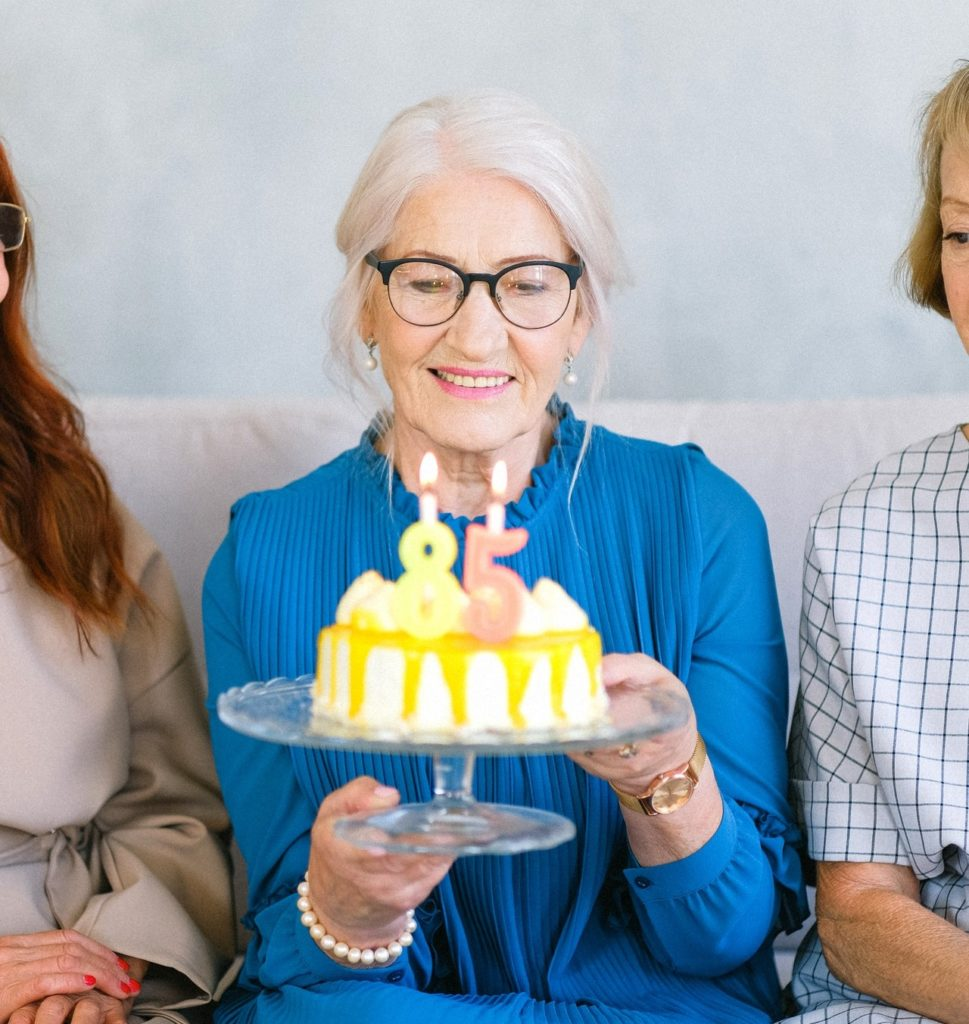 how to live longer. Woman at celebrating her birthday at 85